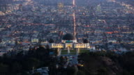 Day to Night View Panning Griffith Park Observatory Over A Sprawling Los Angeles