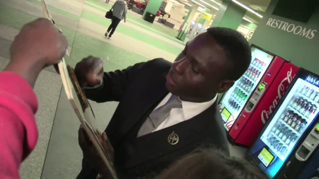 Dayo Okeniyi greets fans at The Hunger Games after party in Los Angeles 03/12/12