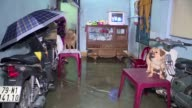 Days of unseasonably torrential rains have killed at least 24 people in central Vietnam authorities say inundating swathes of the region including...