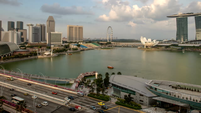 A daytime time lapse view across Marina Bay towards the Bay Sands Hotel