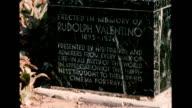 / De Longpre Park on the corner of De Longpre and Cherokee Ave / marble memorial to Rudolph Valentino / CU on memorial text Memorial for Rudolph...