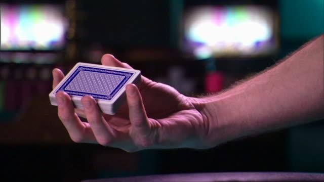 Dealer shuffling cards