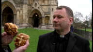 Dean of St Albans claims hot cross bun was invented in St Albans ENGLAND Hertfordshire St Albans Reporter to camera holding up normal hot cross bun...