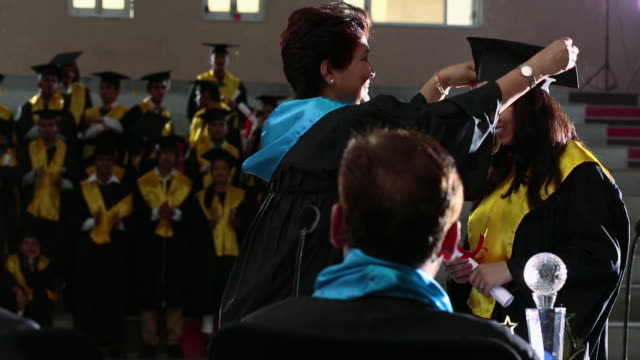 Dean presenting medal to a college student in a graduation day