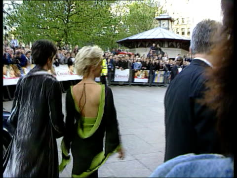 Death inquest LIB ENGLAND London EXT MS Television presenter Paula Yates along to building LIB MS Paula Yates towards from court with exhusband Sir...