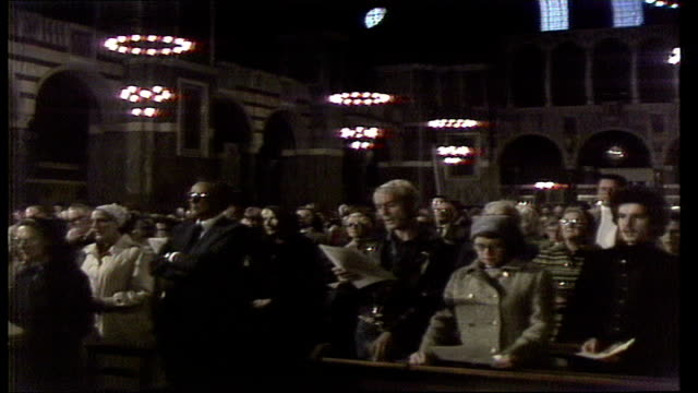 Death of Pope John Paul I Requiem Mass in Westminster Cathedral ENGLAND London CU Candle CS Congregation BV Man on knees wipes eyes MS Archbishop...