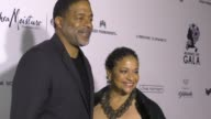Debbie Allen and Norm Nixon at The Wearable Art Gala at California African American Museum on April 29 2017 in Los Angeles California