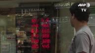 Debilitado por la recesion economica y la crisis politica que acorrala al gobierno de Brasil el real anoto el martes una pagina negra al caer a...