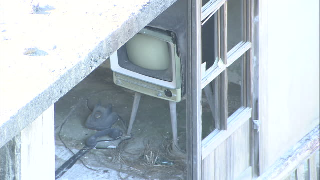 Debris surrounds a television set in an abandoned apartment building in Nagasaki, Japan.