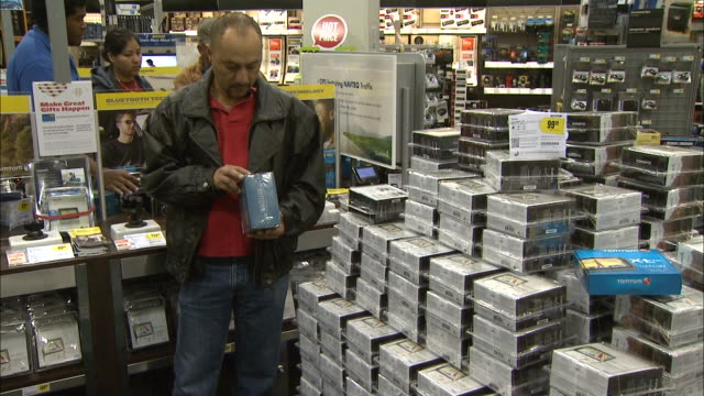 December 16 2010 TS Electronics store associate assisting customers in television department / United States