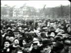 December 1918 MONTAGE large crowd of people in traditional Alsatian dress celebrating an Allied victory after WWI / Colmar Alsace France