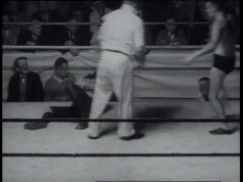December 23, 1936 Blindfolded wrestlers in free-for-all, with referee separating fighters but being hit / United States