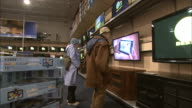 December 24 2010 POV Maneuvering near customers watching instore televisions for a better view / United States