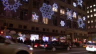 December 5 2008 LA Cars driving by building decorated with neon snowflakes / New York City New York United States