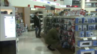 December 8 2010 ZI Customers browsing display of technical wiring and components at Micro Center / United States