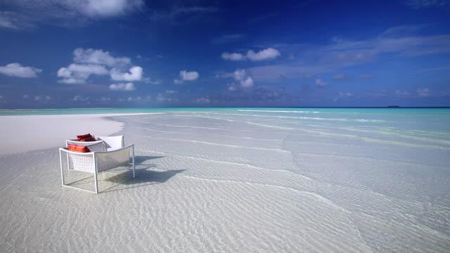 Deck chairs on a tropical beach, Maldives, Indian Ocean