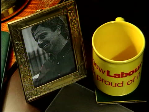 MPS Deck of cards shuffled at desk TCMS Framed picture of Tony Blair beside 'New Labour' mug on desk TILT DOWN to Jokers Jim Fitzpatrick MP interview...
