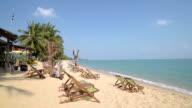 Deckchairs on sandy beach