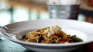 Decorate Spaghetti with basil