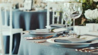 Decorated wedding table. Wedding reception venue with flowers.