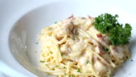 Decorating top of Spaghetti Carbonara with egg