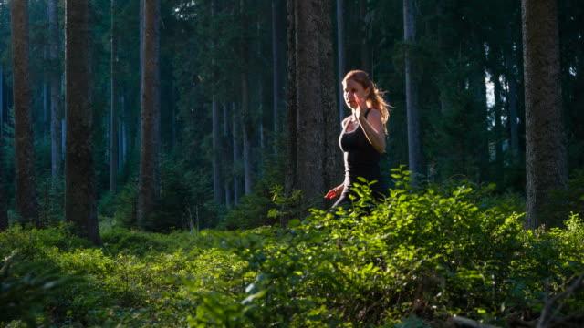 Dedicated athlete running through woods