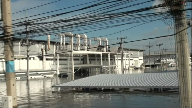 Deep flood waters reach the top of the first floor of a factory in an Ayatthuya industrial estate in Thailand