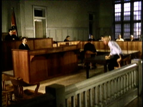 1967 MONTAGE Defendant approaching Judge's bench in Gideon trial / Florida, United States / AUDIO