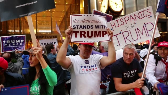 Defiant Donald Trump supporters gather outside of Trump Towers in Manhattan October 8 2016 in New York City The Donald Trump campaign has faced...