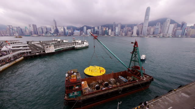 Deflated Rubber Duck in Hong Kong with Crane Boat - Skyline