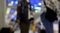 Defocused Airport Travelers.
