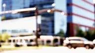 Defocused downtown intersection with tall buildings