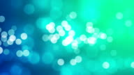 Defocused glitter on blue and green colour