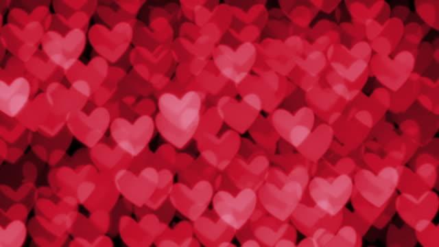 Defocused heart shaped candle lights.