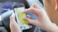 Defocused of businessman using smartphone in car,Close-up