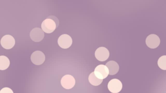 Defocused particles floating in a seamless loop.