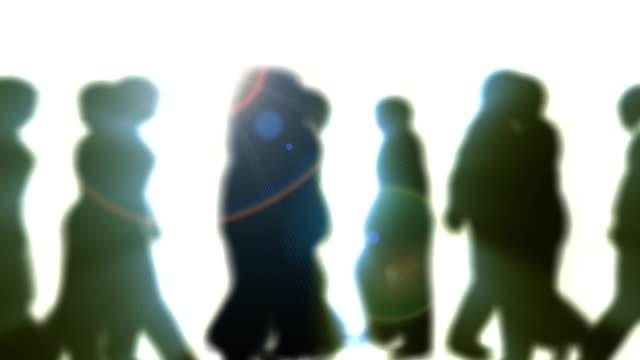 Defocused People Walking By (Silhouette)