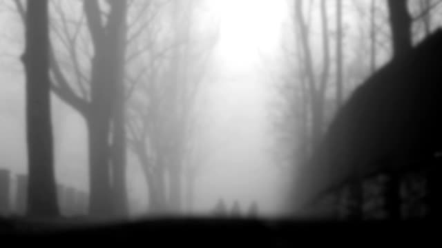 Defocused people walking in the fog,