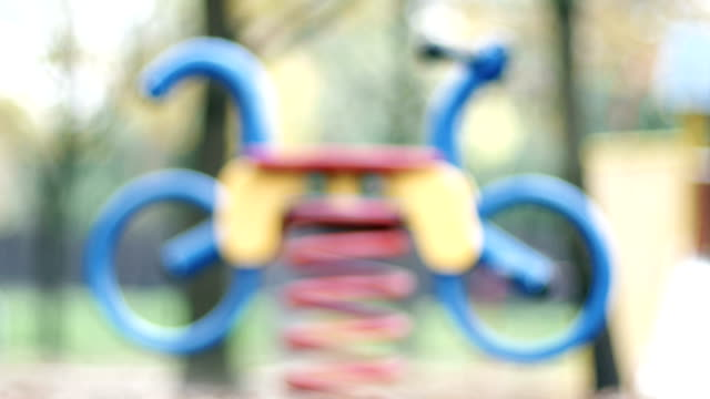 Defocused Toy Bike on Playground P