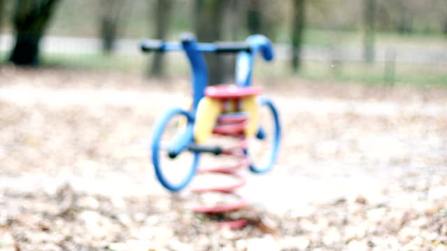 Defocused Toy Bike on Playground