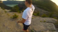 360 degrees slow motion selfie recording a guy from every perspective trekking the Catalan mountains with action on sunset and stunning landscape.