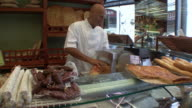 MS Deli worker slicing prosciutto / Lucca, Tuscany, Italy