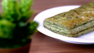 Delicious green tea pie with red bean filling on a white plate