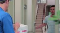 Delivery man knocking on front door, delivering parcel