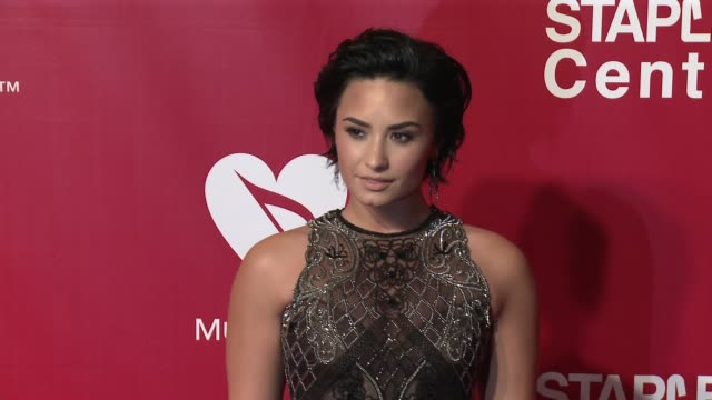 Demi Lovato at the 2016 MusiCares Person of The Year Honoring Lionel Richie at Los Angeles Convention Center on February 13 2016 in Los Angeles...