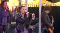 PERFORMANCE Demi Lovato at Topshop Topman LA Grand Opening At The Grove in Los Angeles CA on 2/14/13