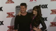 Demi Lovato Simon Cowell at The X Factor Viewing Party Sponsored By Sony X Headphones on in Los Angeles CA