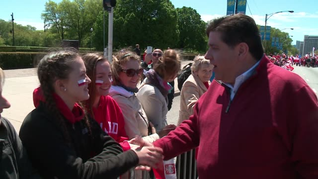 WGN Democratic Governor Candidate JB Pritzker Walk in the Polish Constitution Day Parade Shakes Hands with Spectators About 10000 people lined an...