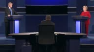 Democratic Party presidential candidate Hillary Clinton and Republican Party presidential candidate Donald Trump argue the topic of trade in the...