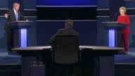 Democratic Party presidential candidate Hillary Clinton and Republican Party presidential candidate Donald Trump discuss economic policy proposals...